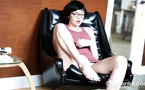 Ivy Hamilton spreads on a leather sofa and teases her tight