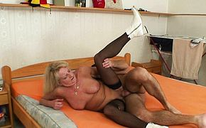 Blonde  years old grandma in black stockings
