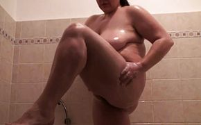 Busty babe next door takes a hot shower