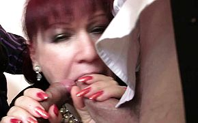 Two men share sexy redhead mature office boss