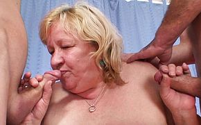 Very old busty grandma sucks and rides two cocks